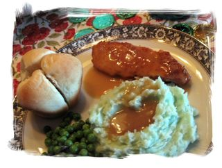 chicken, green mashed potatoes, peas and clover rolls